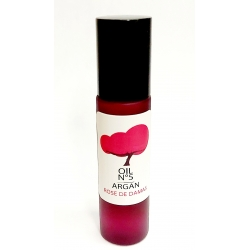 oragnic argan oil infused with rosa damascena. rechargeable pink glass roller bottle