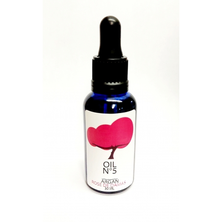 Organic argan oil infused with rosa damascena.  Dark glass blue bottle. 30ml with pipette