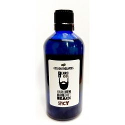 Organic Extra Virgin Argan Oil, Premium quality, infused with a spicy mix of essential oils.  100ml blue glass bottle