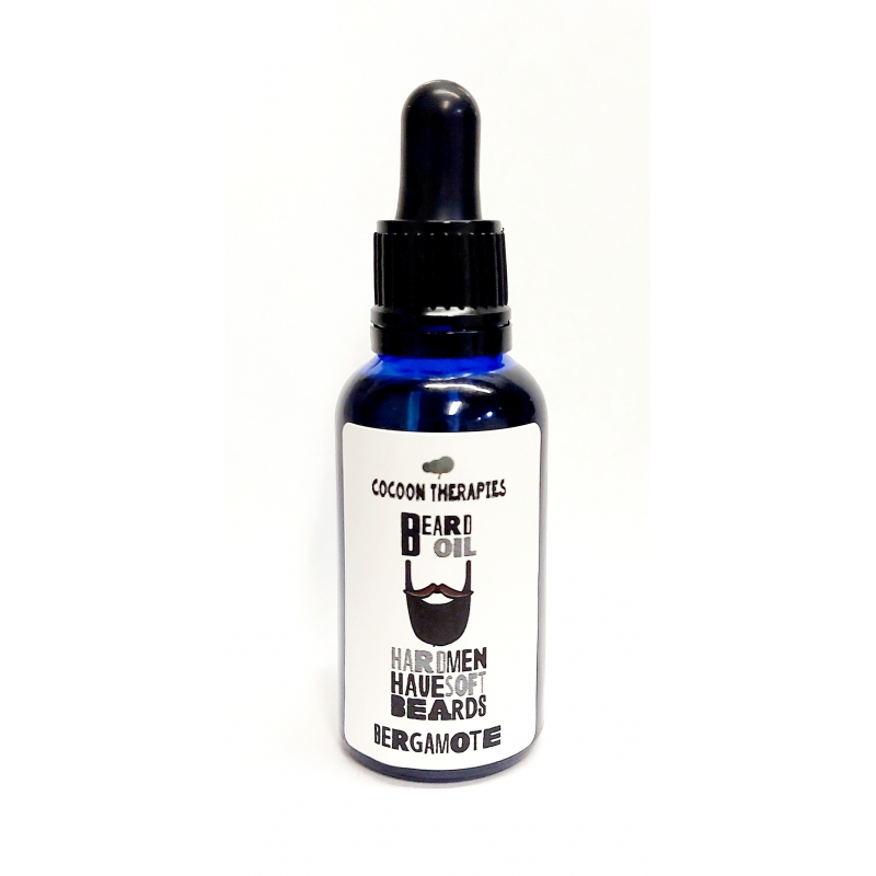 beard oil. Organic argan oil infrused with bergamote essential oil. 30ml blue glass bottle with pipette